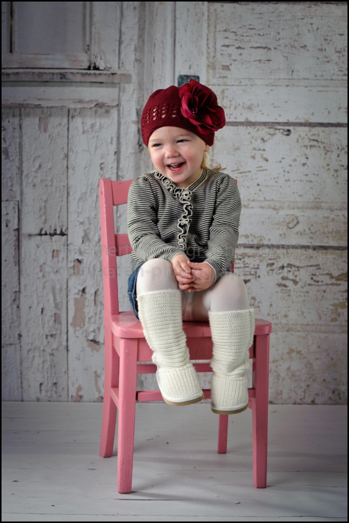 Two Year Old in pink chair portraits at St Charles Children's Photographer studio