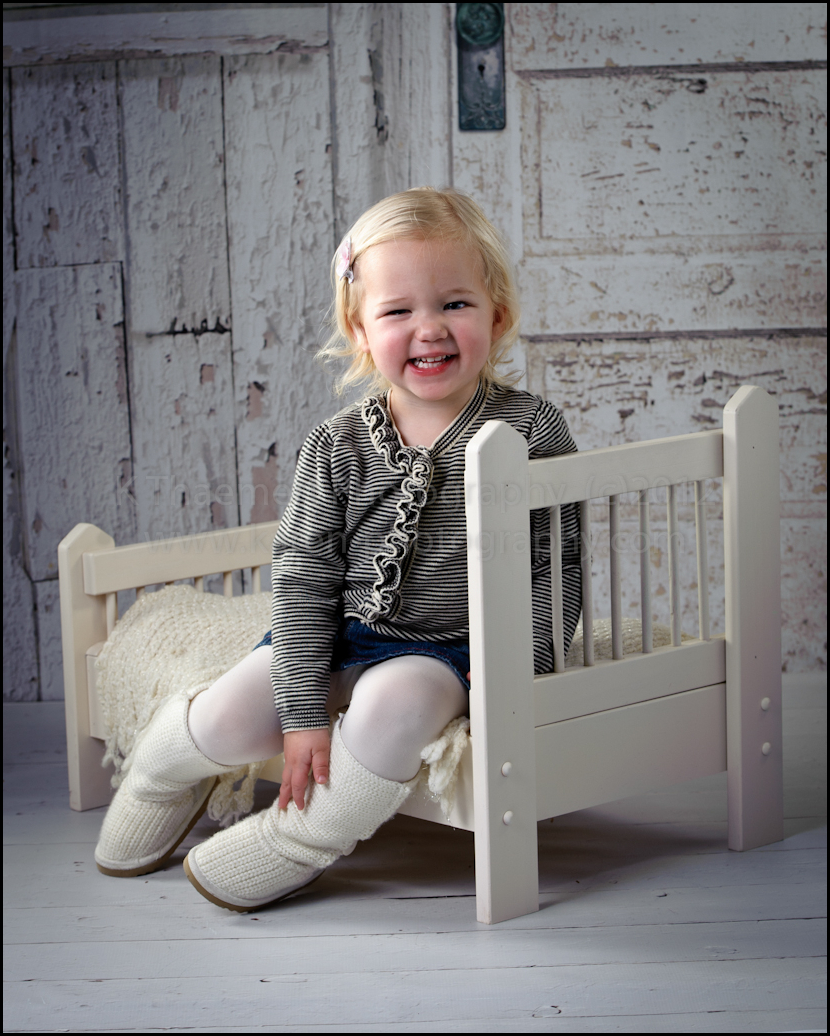 Baby bed for two year old - Two Year Old Sitting On Baby Bed At St Charles Children S Photographer Studio