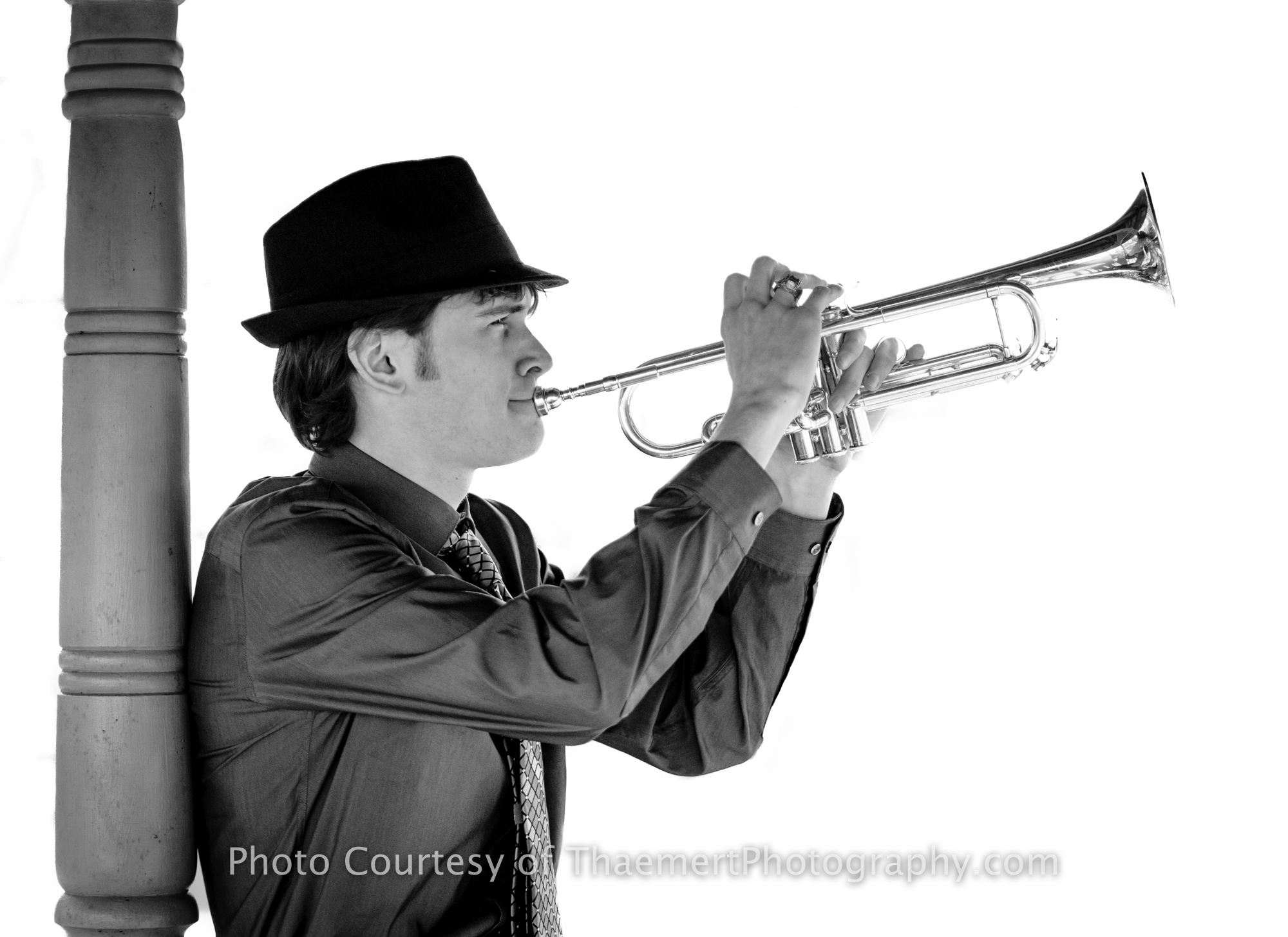 Fun Senior pictures with his Trumpet