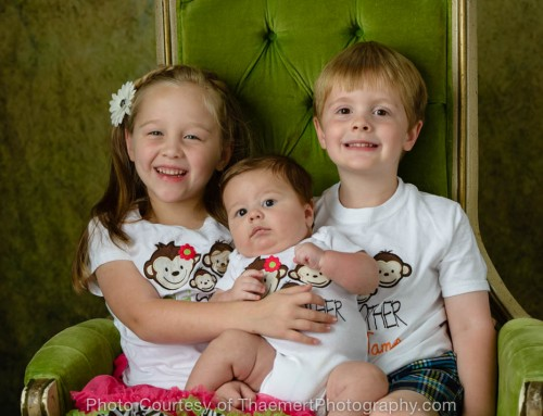 Fun sibling photo of baby boy by St Charles Photographer