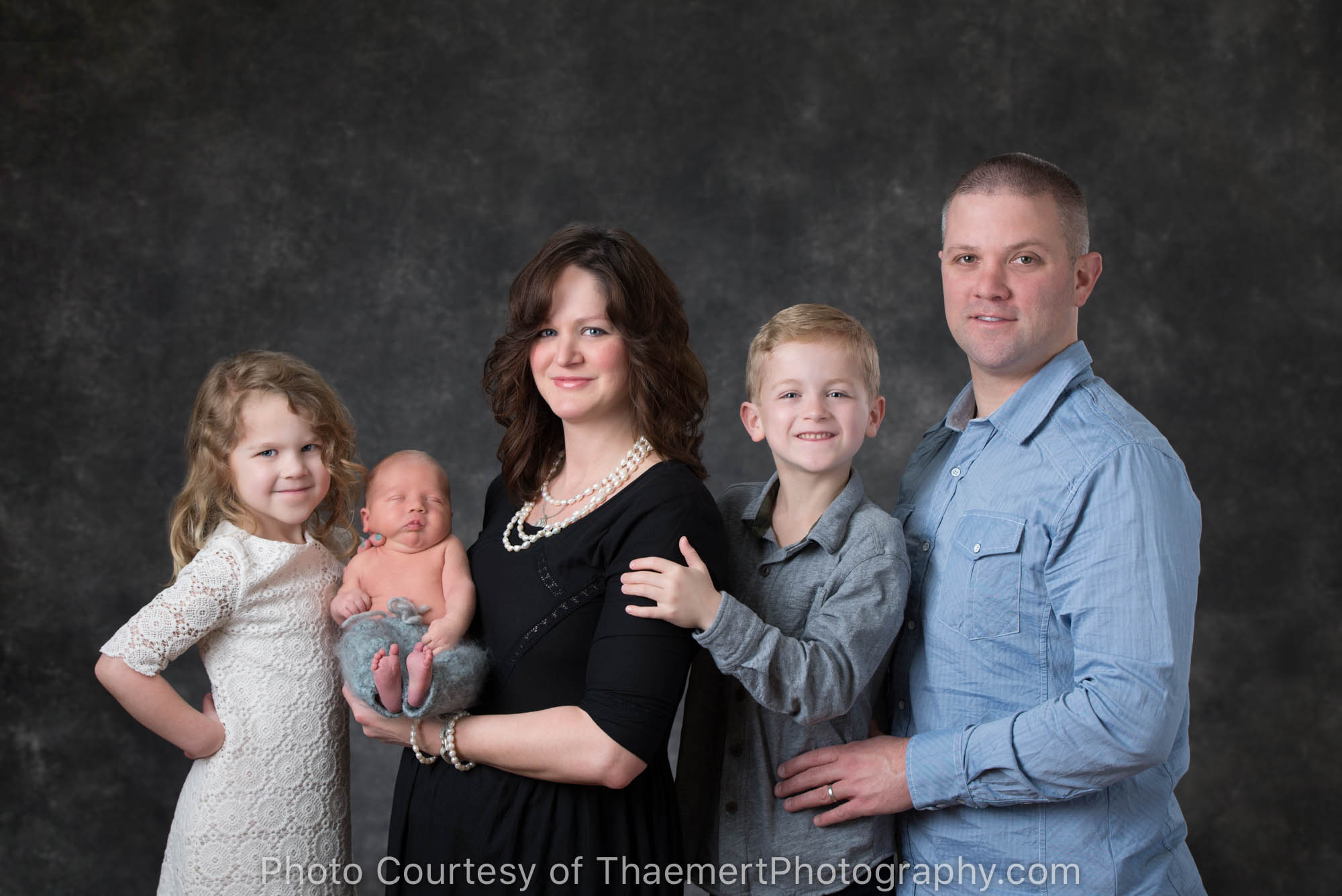 Beautiful family heritage portrait in the studio with newborn baby boy