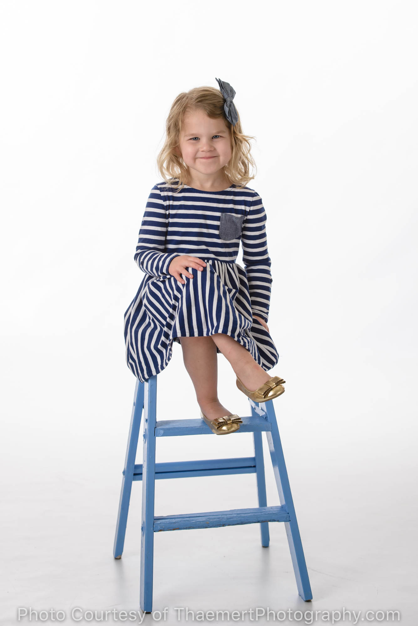 Toddler Birthday Photos of little girl on a blue stool in the Studio