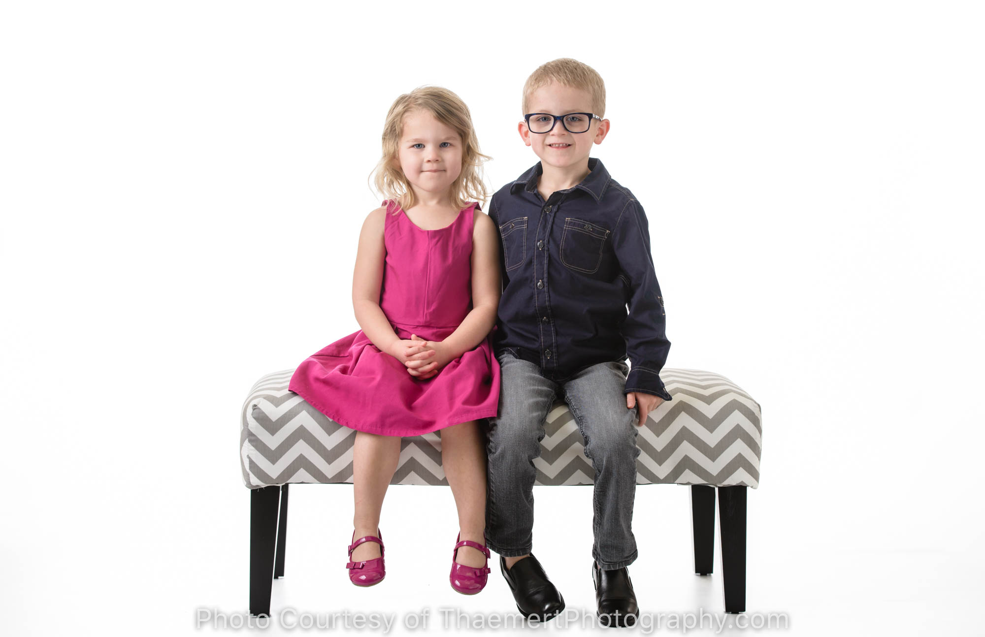 Siblings pose for St Charles Kids Photographer in the studio