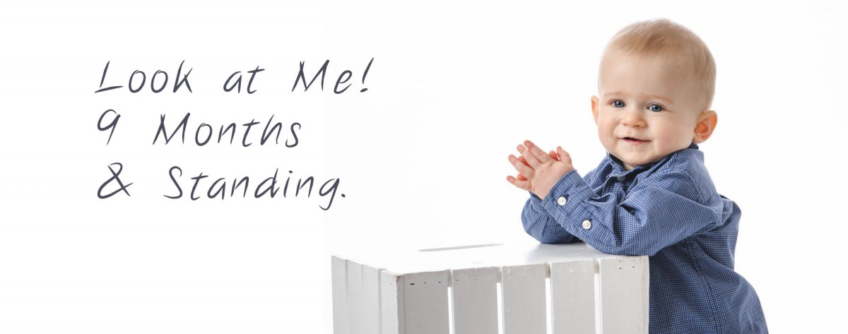9 Month Portraits of standing boy