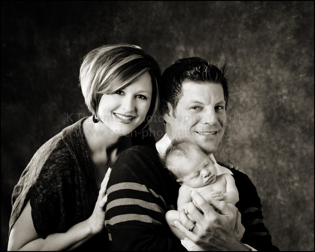 New parents with newborn baby boy St Charles Photographer