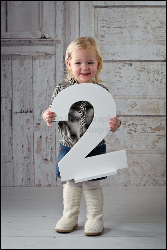 Two Year Old with wooden 2 portrait at St Charles Children's Photographer  studio