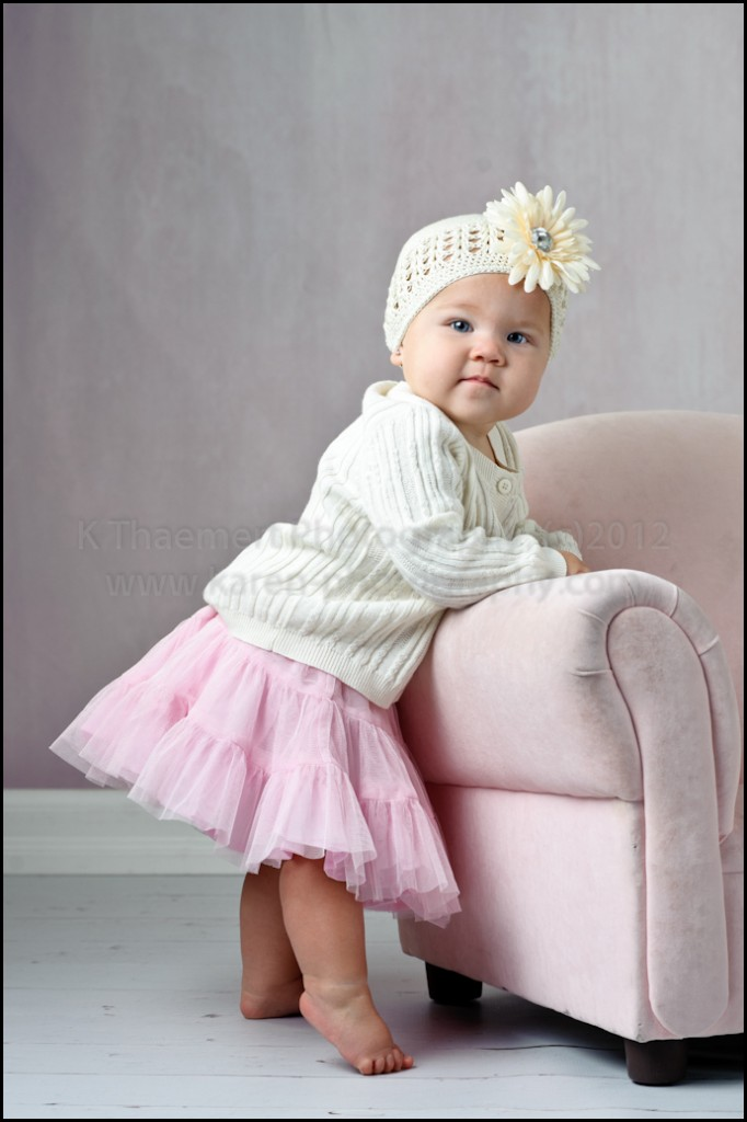 9 Month baby girl posing like a ballerina by St Charles Baby Photographer