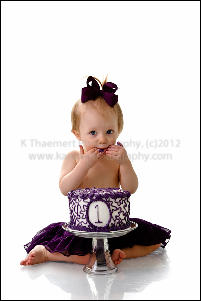 St Charles Child Photographer photo of first birthday girl eating cake