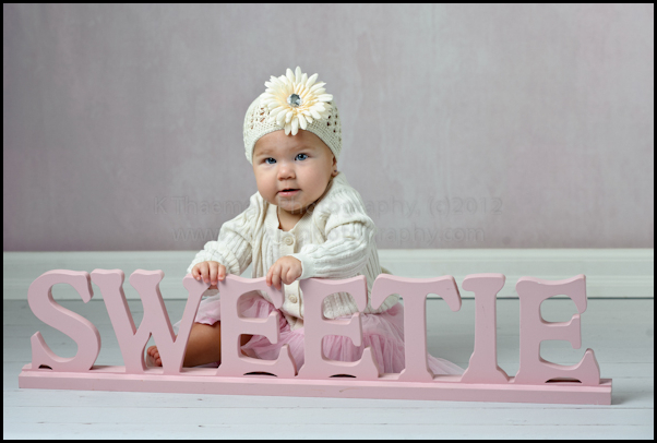 9 month baby girl studio portrait by St Charles Baby Photographer