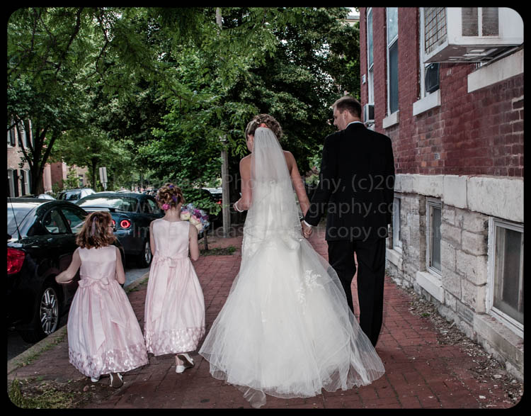 St Charles Wedding Photographer with bride groom and flower girls