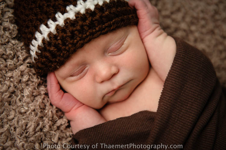 Baby Boy in Football hat by St Charles Newborn Photographer