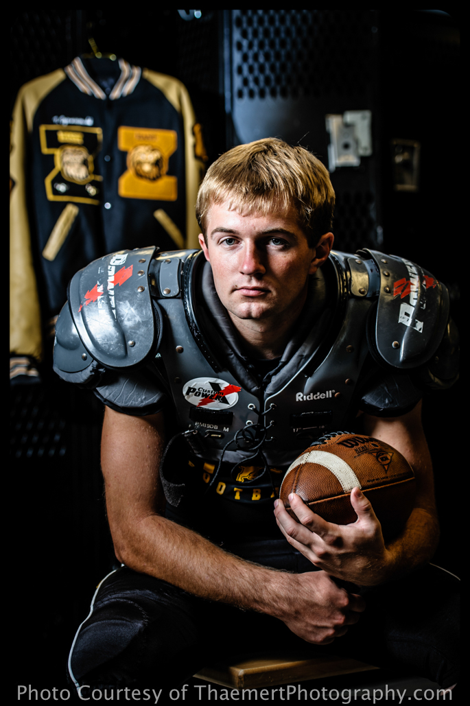 St Charles Senior Photographer Football Player in locker room