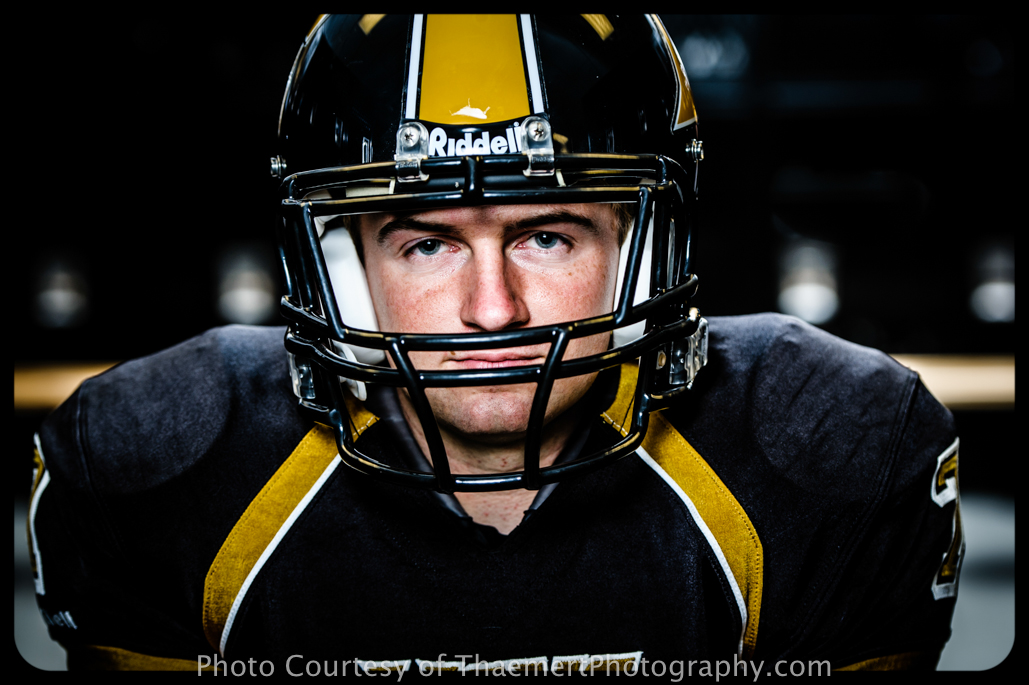 St Charles Senior Photographer Football Player in helmet