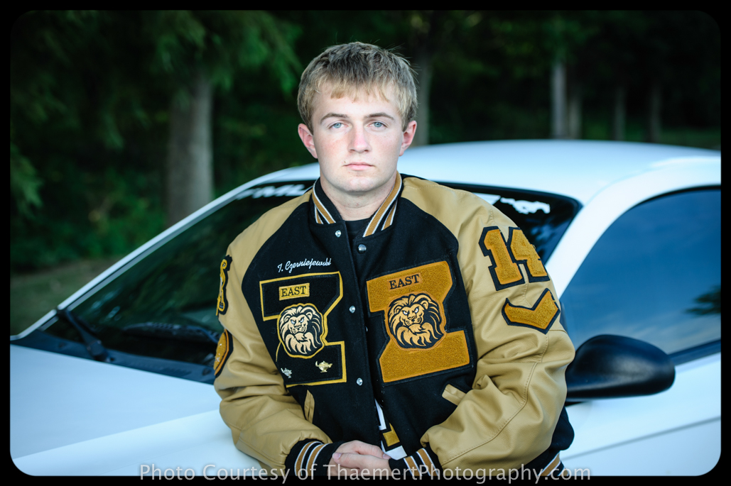 St Charles Senior Photographer guy photos letter jacket