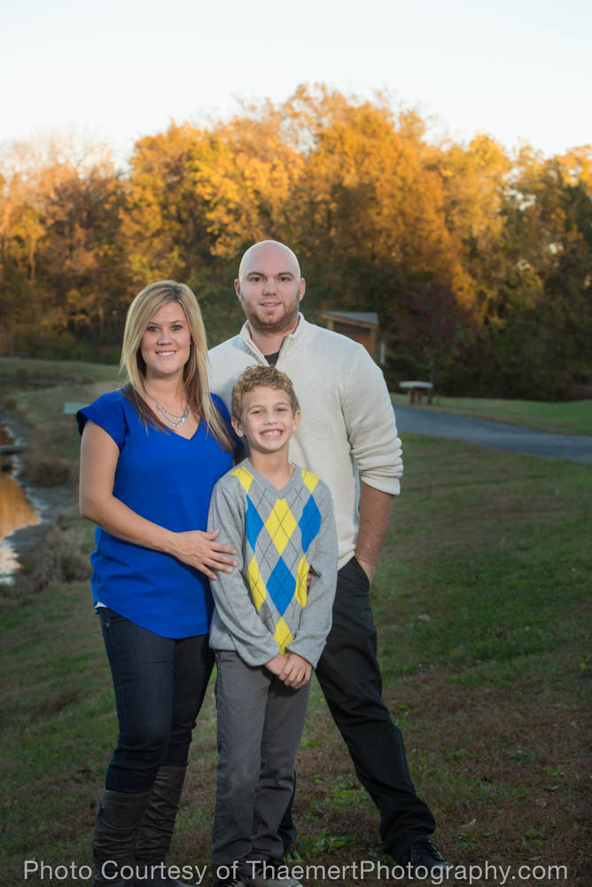 Family photo by the lake by St Charles Family Photographer