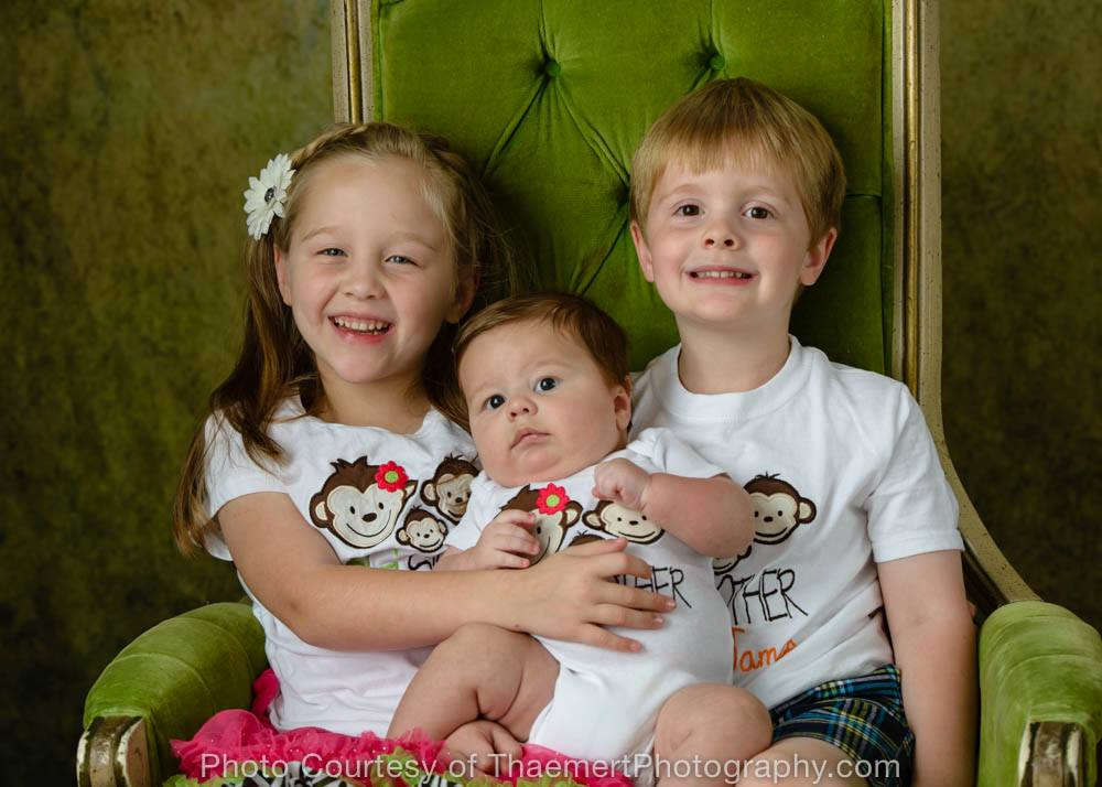 Sibling photoshoot with new baby