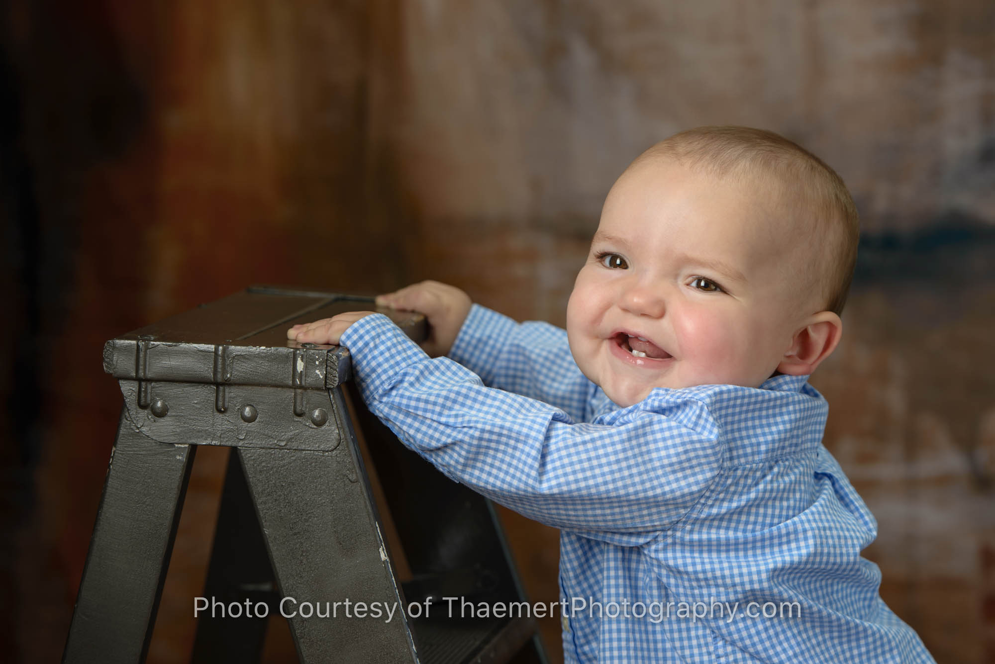 1 year old baby boy by ladder pictures by St Charles Baby Photogapher
