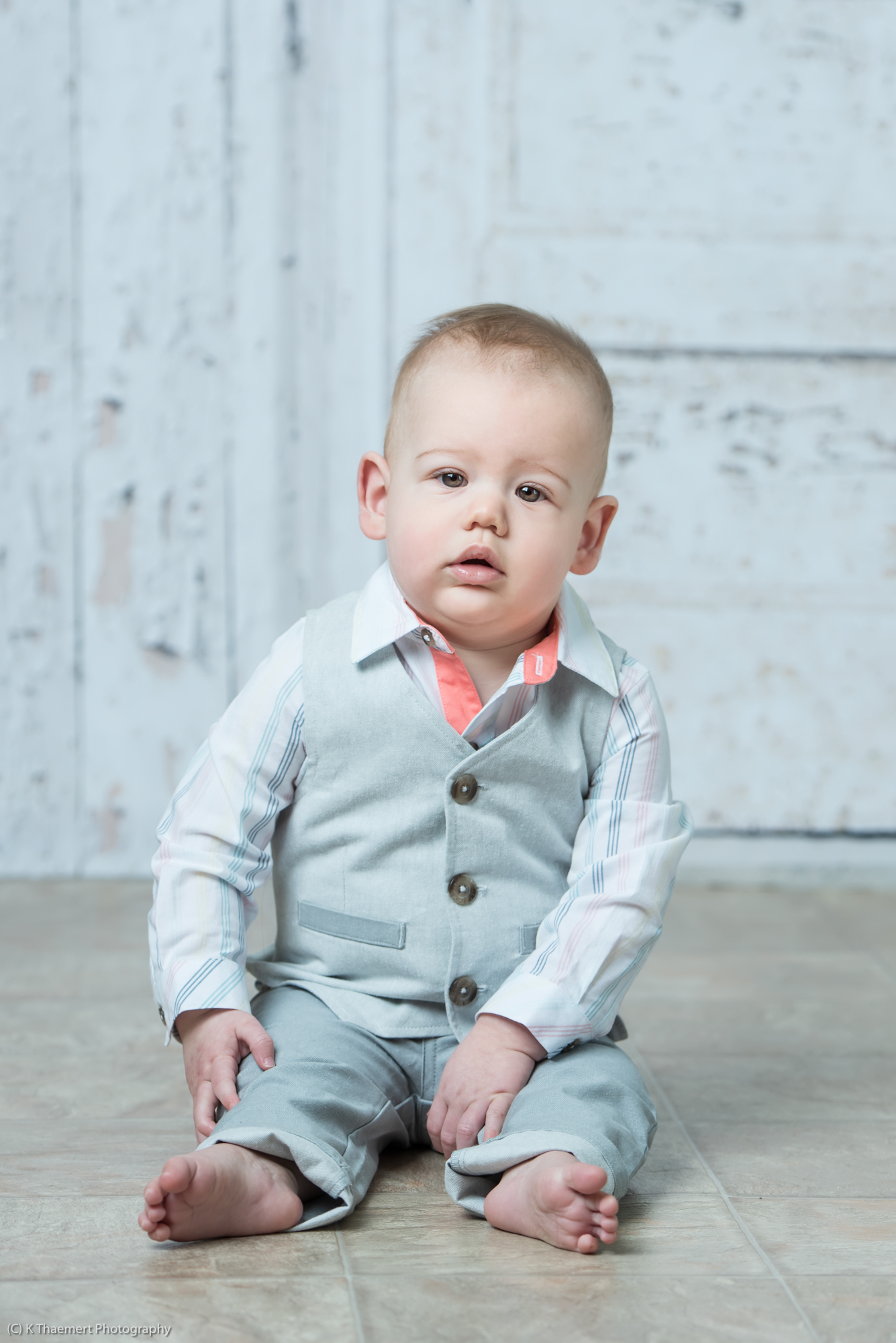 Sitting Baby boy dressed in Sunday best