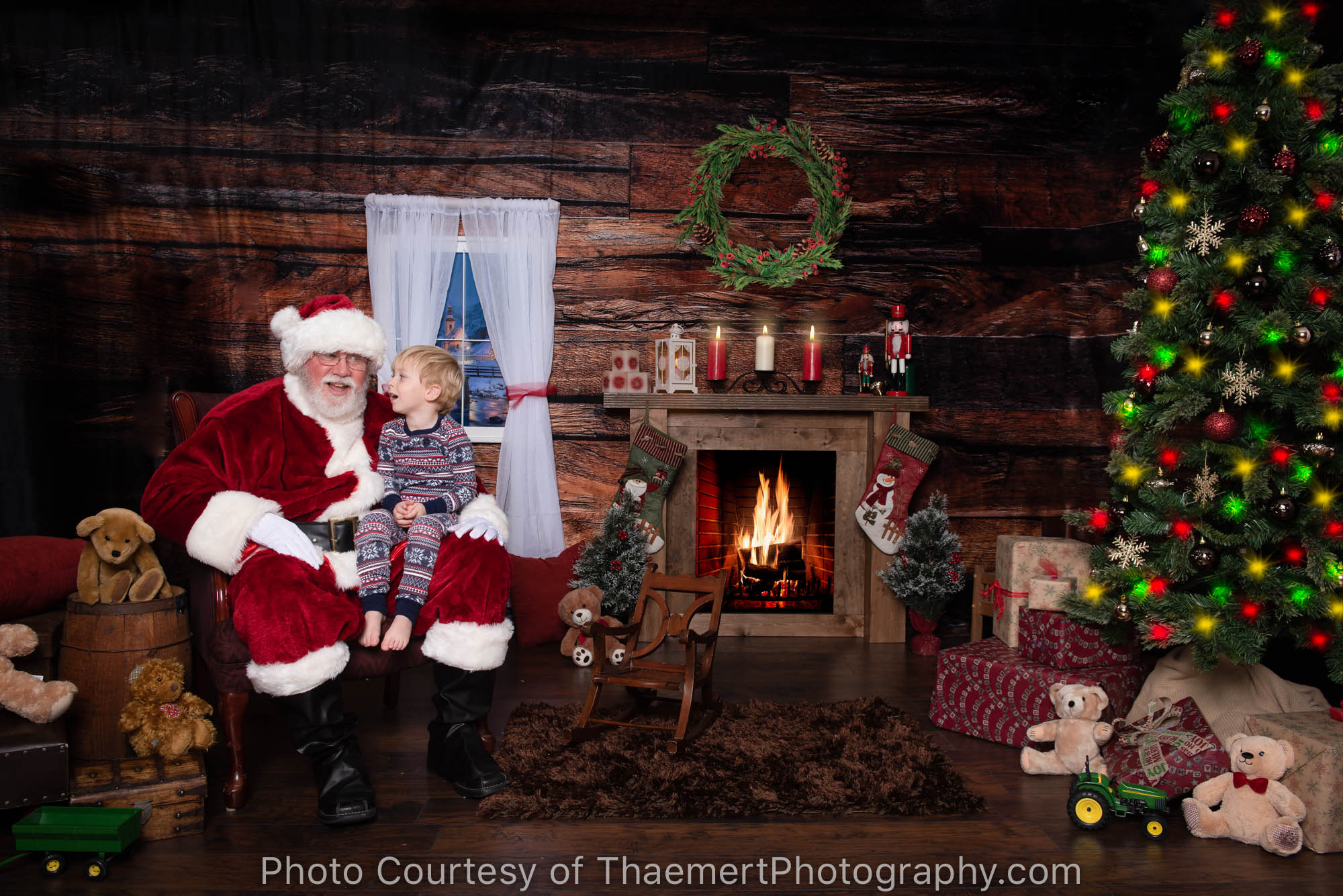 Little Boy telling his wishes to Santa at his Santa Experience Portrait Session