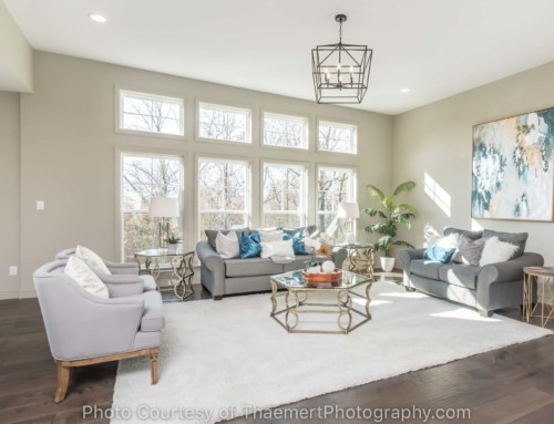 Spacious living room with picture windows real estate photo