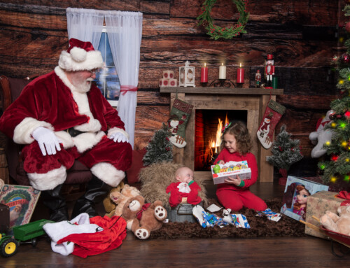 Santa gives gifts to baby and Toddler – Santa Experience Photo Session